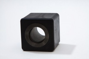 Vibration dampener with rubber to metal bonding.